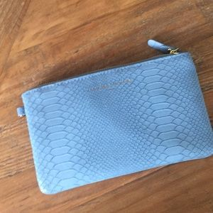 Unique Clutch with cell phone charger-NWOT
